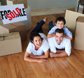 Family moving house on floor smiling at the camera - PhotoDune Item for Sale