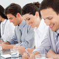 Young business people taking notes at a conference - PhotoDune Item for Sale