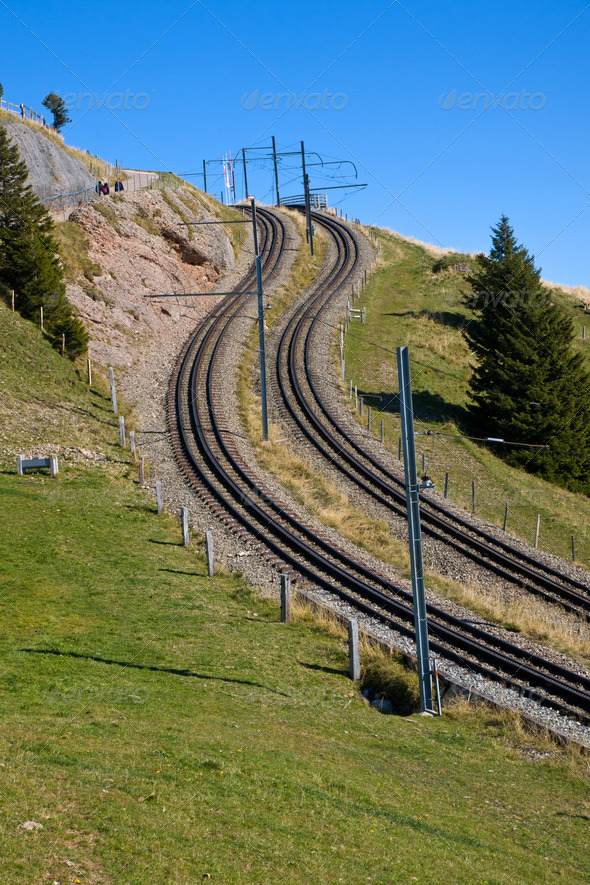 Railroad tracks in the alps - Stock Photo - Images