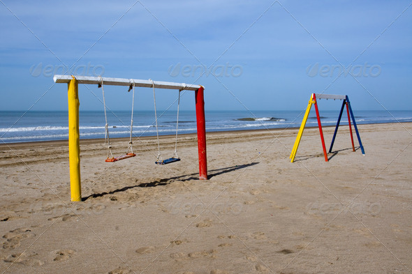 Swings at the beach - Stock Photo - Images