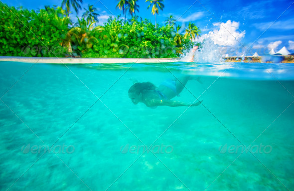 Swimming near tropical island - Stock Photo - Images