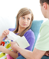 Assertive man giving his ill girlfriend tissue - PhotoDune Item for Sale