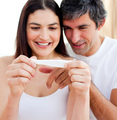 Blissful couple finding out results of a pregnancy test