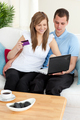 Happy couple using a laptop to buy online - PhotoDune Item for Sale
