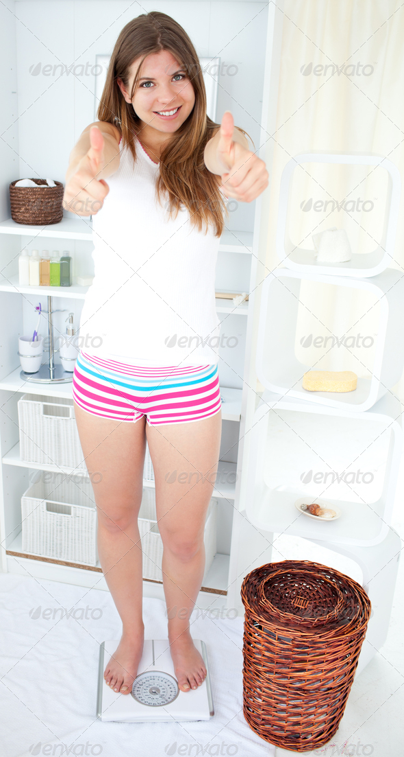 Beautiful girl standing at the balance - Stock Photo - Images