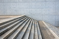 Granite stairs and a concrete wall