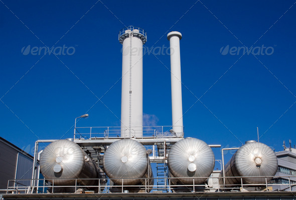 Silver tanks with smokestacks - Stock Photo - Images