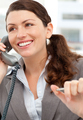 Smiling businesswoman talking on the phone