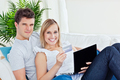 young couple with laptop and credit card bying online lying in t - PhotoDune Item for Sale