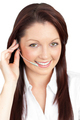 Merry young businesswoman wearing headphones - PhotoDune Item for Sale
