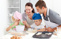 Happy family cooking a cream together in the kitchen - PhotoDune Item for Sale