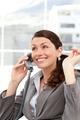 Joyful businesswoman talking on the phone