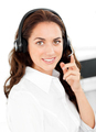 Positive woman with headset working in a call center - PhotoDune Item for Sale