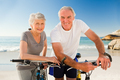 Retired couple with their bikes on the beach - PhotoDune Item for Sale