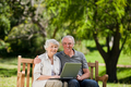 Elderly couple looking at their laptop - PhotoDune Item for Sale