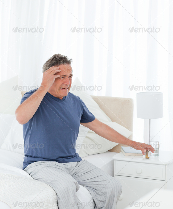 Man having a headache - Stock Photo - Images