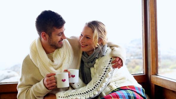 Cute Couple Cuddling Together Under A Blanket By Lightwavemedia