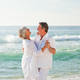Download Retired couple dancing on the beach from PhotoDune