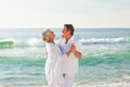 Retired couple dancing on the beach - PhotoDune Item for Sale