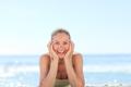 Lovely woman sunbathing at the beach