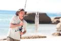 Man fishing at the beach - PhotoDune Item for Sale