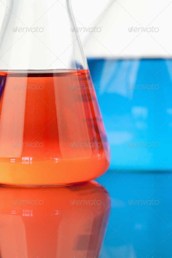 Blue and red beakers - Stock Photo - Images