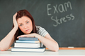 Young student stressed by her examinations - PhotoDune Item for Sale