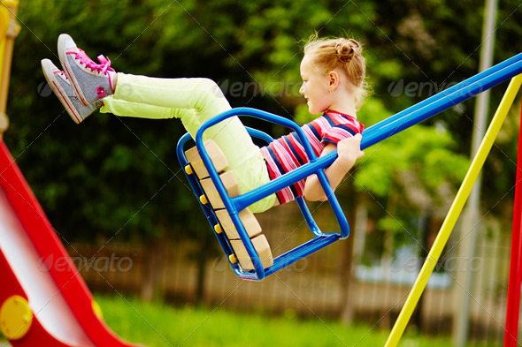 Girl on swing - Stock Photo - Images