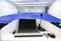 Laptop on the rostrum in conference hall. - PhotoDune Item for Sale