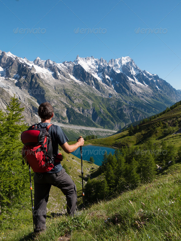 Hiker admiring mountain landscape in Val Veny, Mont Blanc, Courmayer, Italy, Europe. - Stock Photo - Images