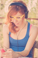 Beautiful hipster girl with headphones listening to the music - PhotoDune Item for Sale