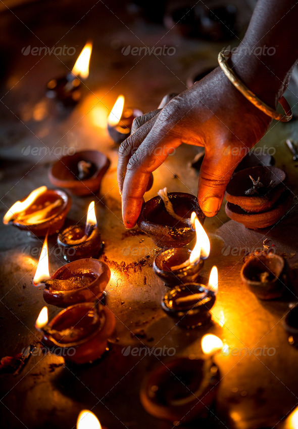 Burning candles in the Indian temple. - Stock Photo - Images