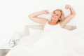 Blonde woman stretching her arms - PhotoDune Item for Sale