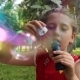 Little Girl Playing With Bubbles - VideoHive Item for Sale