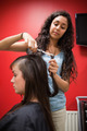 Portrait of a student hairdresser cutting hair