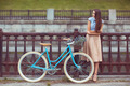 Young beautiful, elegantly dressed woman with bicycle, summer an - PhotoDune Item for Sale
