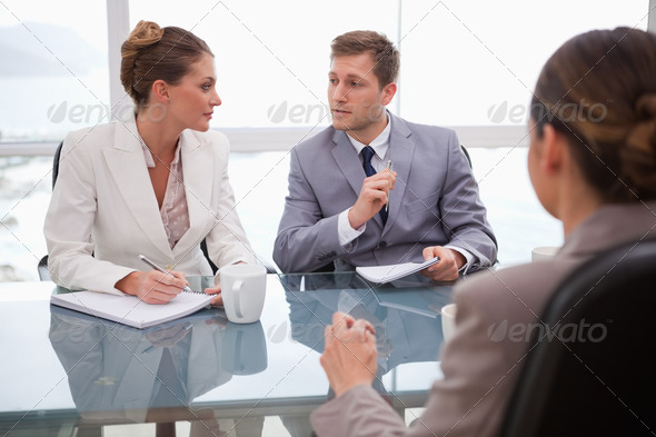 Business team deliberating with lawyer - Stock Photo - Images