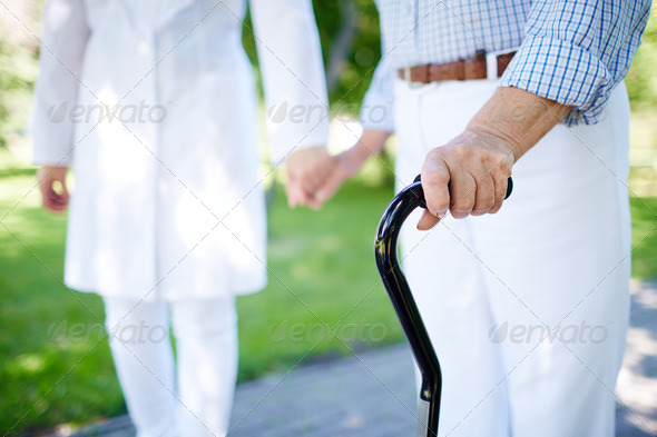 Walking with cane - Stock Photo - Images