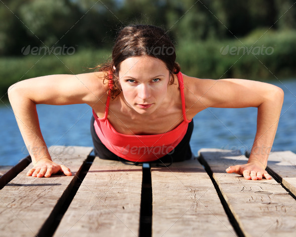 Woman doing push-ups - Stock Photo - Images