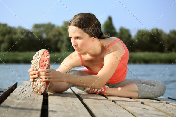 Woman doing stretching exercis - Stock Photo - Images