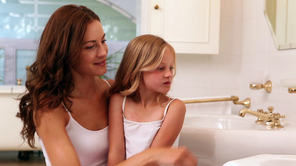 Mother And Daughter Brushing Their Teeth 1 Stock Footage
