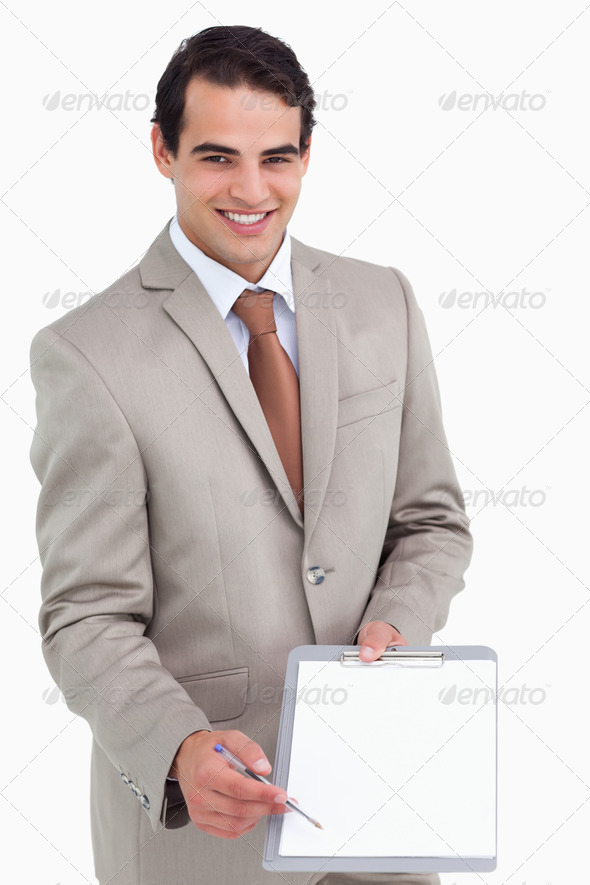 Smiling salesman asking for signature - Stock Photo - Images