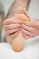 Fingers palpating the sole of a foot in a room - PhotoDune Item for Sale