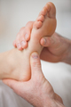 Close-up of two hands massaging a foot in a room - PhotoDune Item for Sale