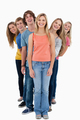 A smiling group of people standing and looking at the camera - PhotoDune Item for Sale