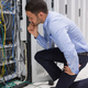 Download Technician checking server in data center from PhotoDune