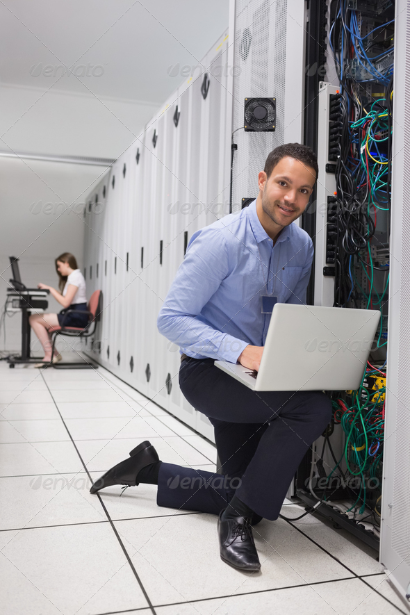 Two people doing data storage with laptops - Stock Photo - Images