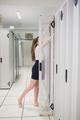 Woman reaching into servers in data center - PhotoDune Item for Sale