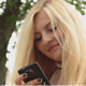 Girl Holding a Mobile Phone - VideoHive Item for Sale
