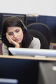 Tired woman in computer room in college